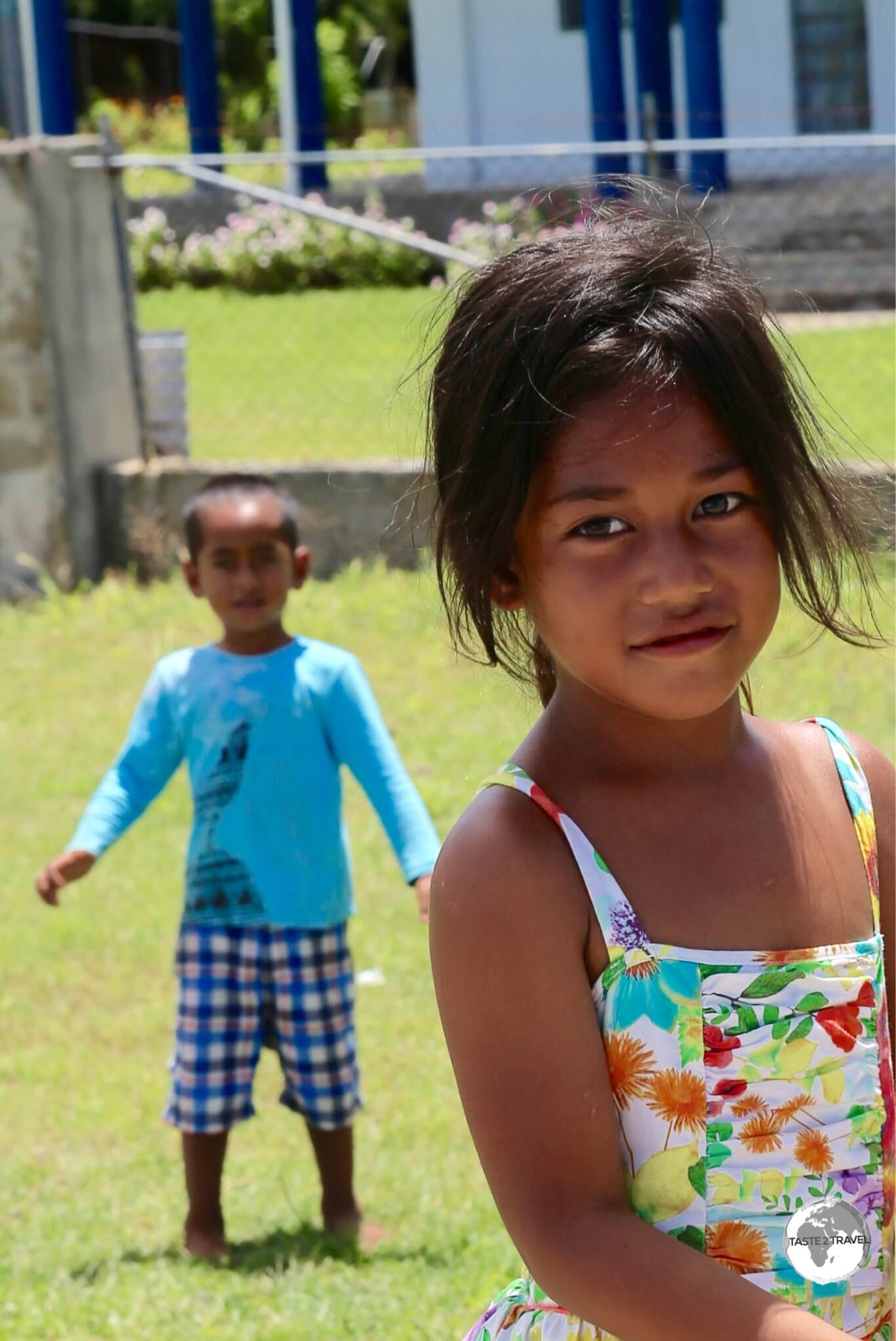 A brother & sister playing in a quiet neighbourhood on Tongatapu.