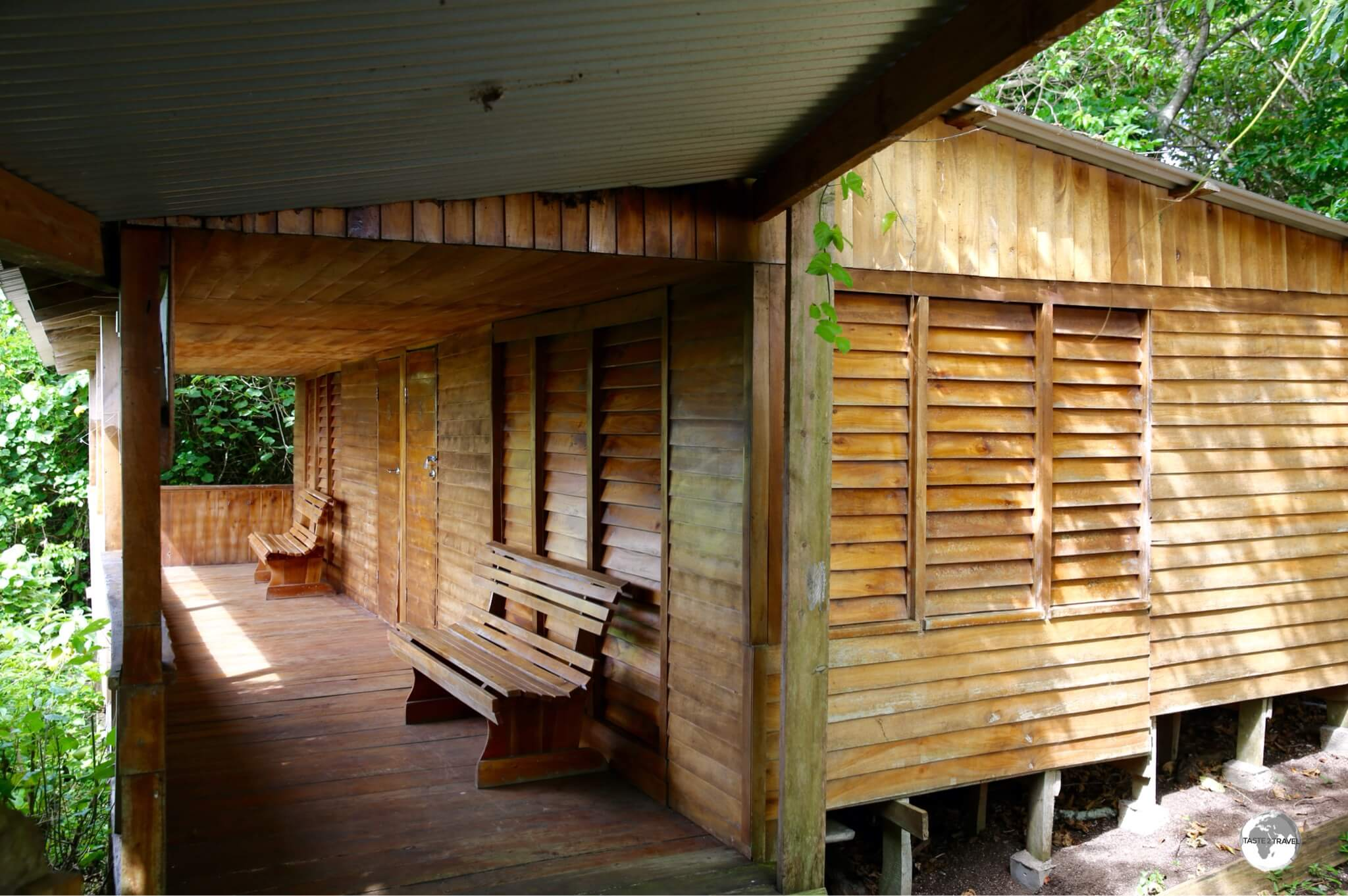 Ovava Tree Lodge features wooden 'Fales' in a lush garden setting.