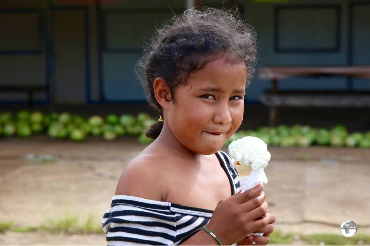 I scream ice-cream! A young girl enjoying an ice cream on 'Eua Island.