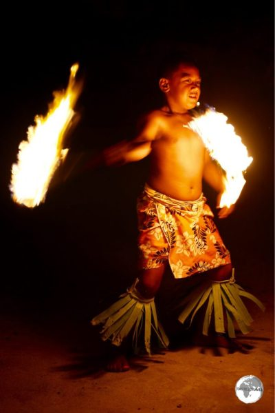 A Fire dance performer at Hina Cave.