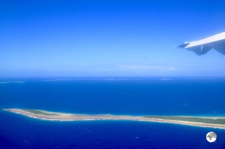 A view of Tuvalu from my Fiji Airways flight. The thin, flat atolls are slowly being inundated due to rising sea levels.