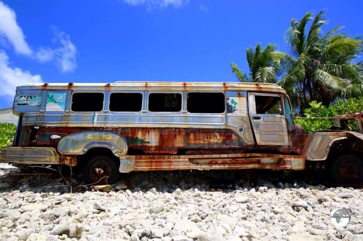 An abandoned Filipino Jeepney lies on the beach on Funafuti - a long way from home.