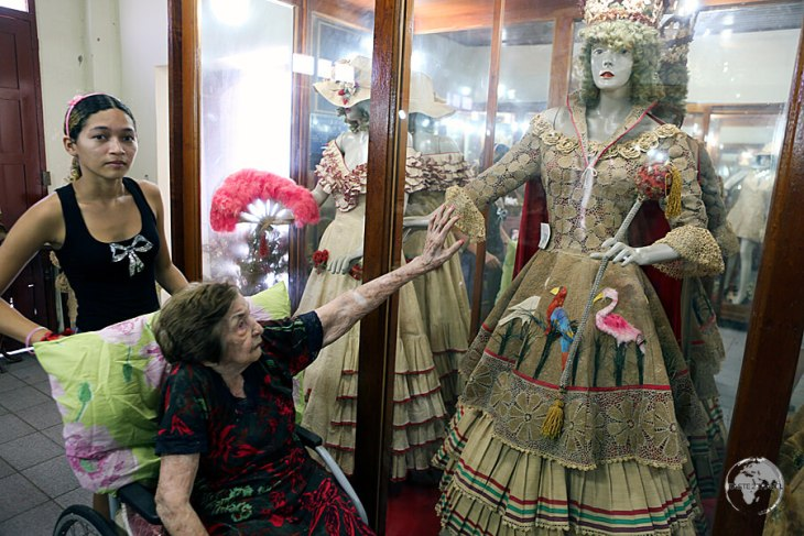 Dica Frazão, who sadly passed away in 2017, providing me with a personal tour of her unique collection of costumes, all of which were made by her from local natural fibres.