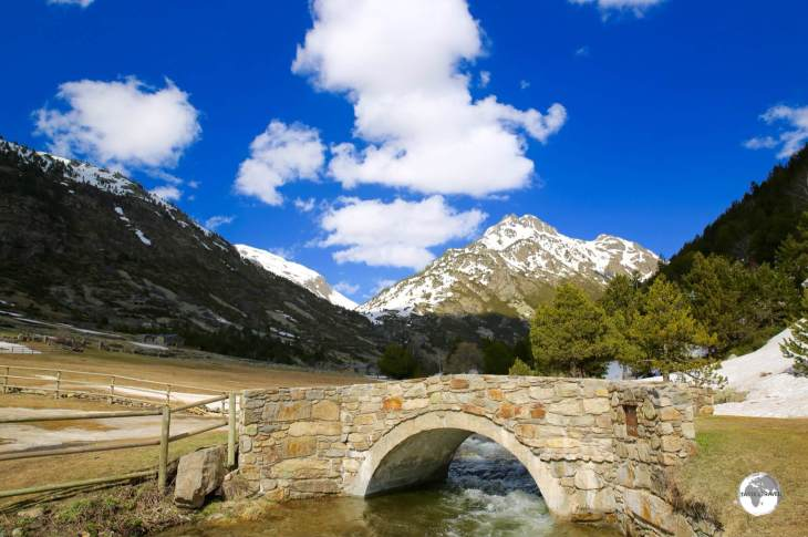 A stone bridge crosses the River Incles in the pretty Vall d'Incles.