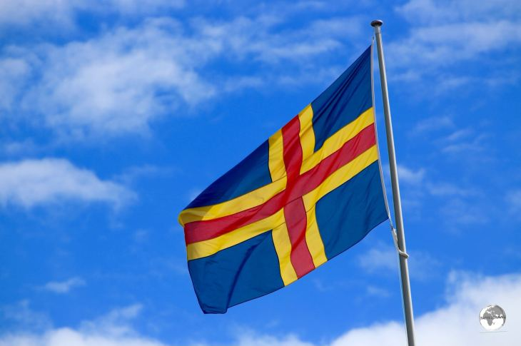 The flag of the Aland Islands flying outside parliament in Mariehamn.