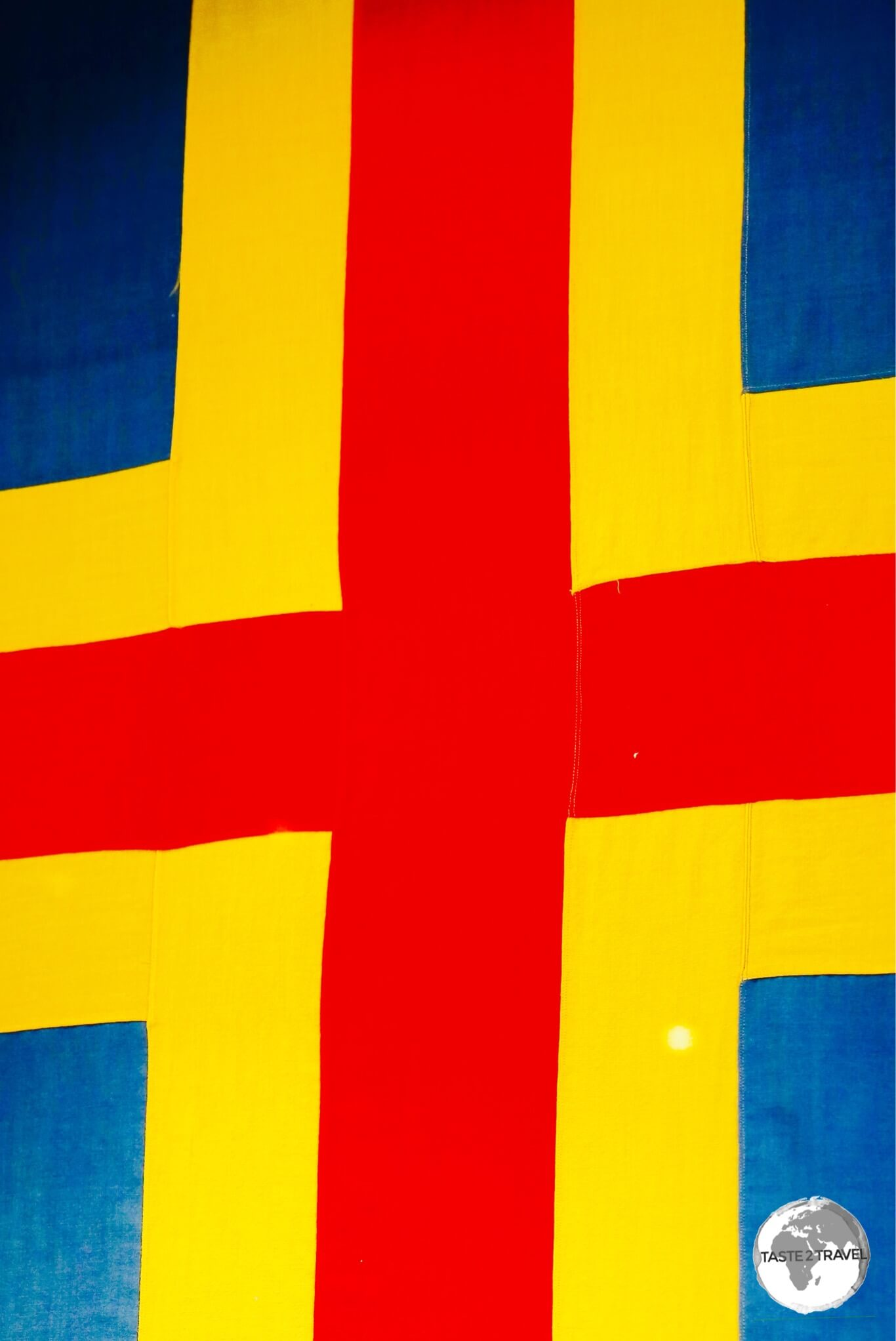 The flag of the Aland Islands is a Swedish flag over-layed with a red cross.