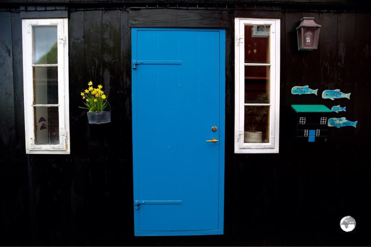 Despite being a treeless archipeligo, many houses on the Faroe Islands are constructed from timber and painted glossy colours - including black. This makes for a nice contrasting background onto which colourful ornaments are added.