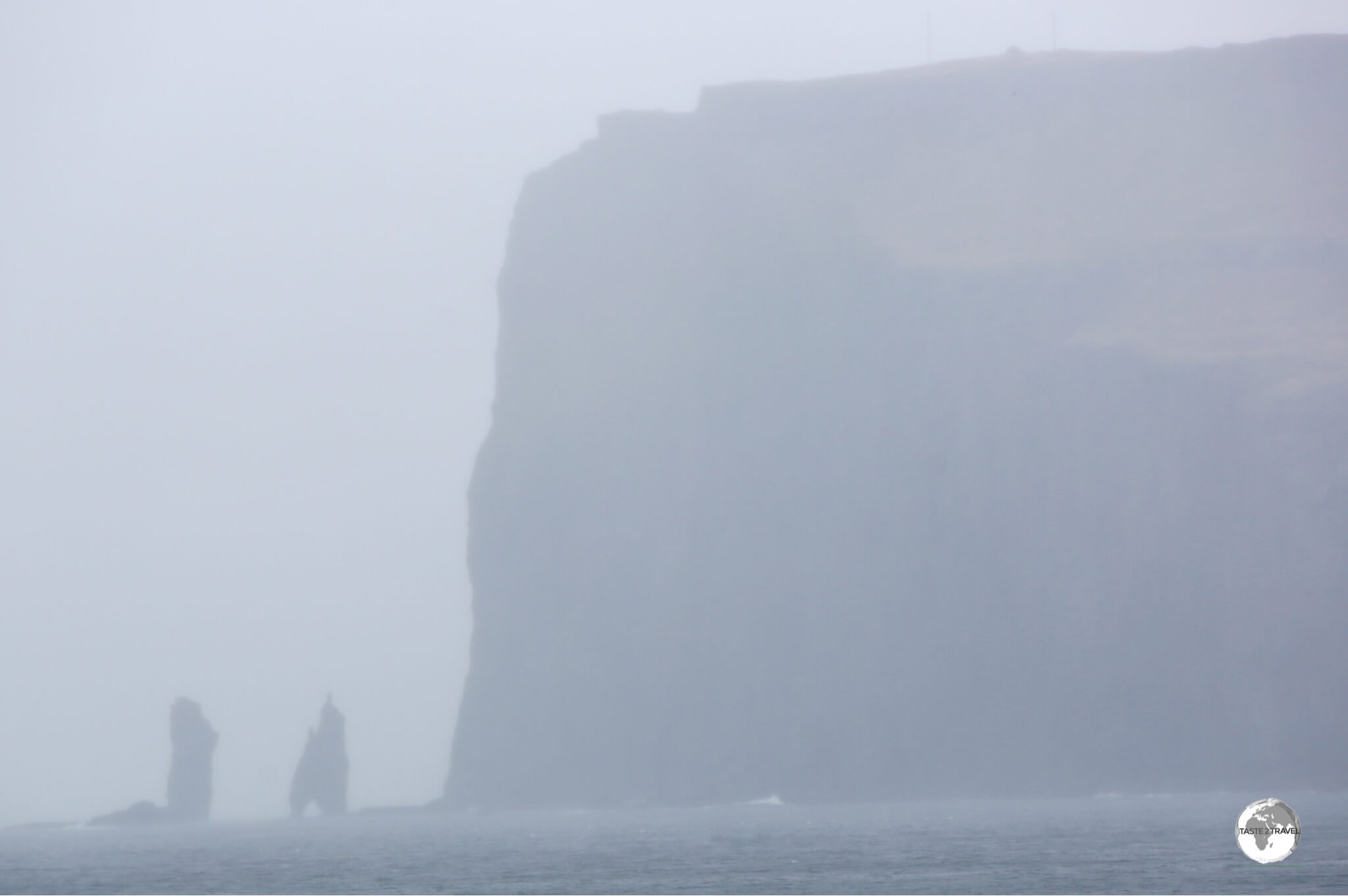 A view of the soaring 343-metre-high Eiðiskollur promontory with the two 75-m high sea stacks - Risin og Kellingin.