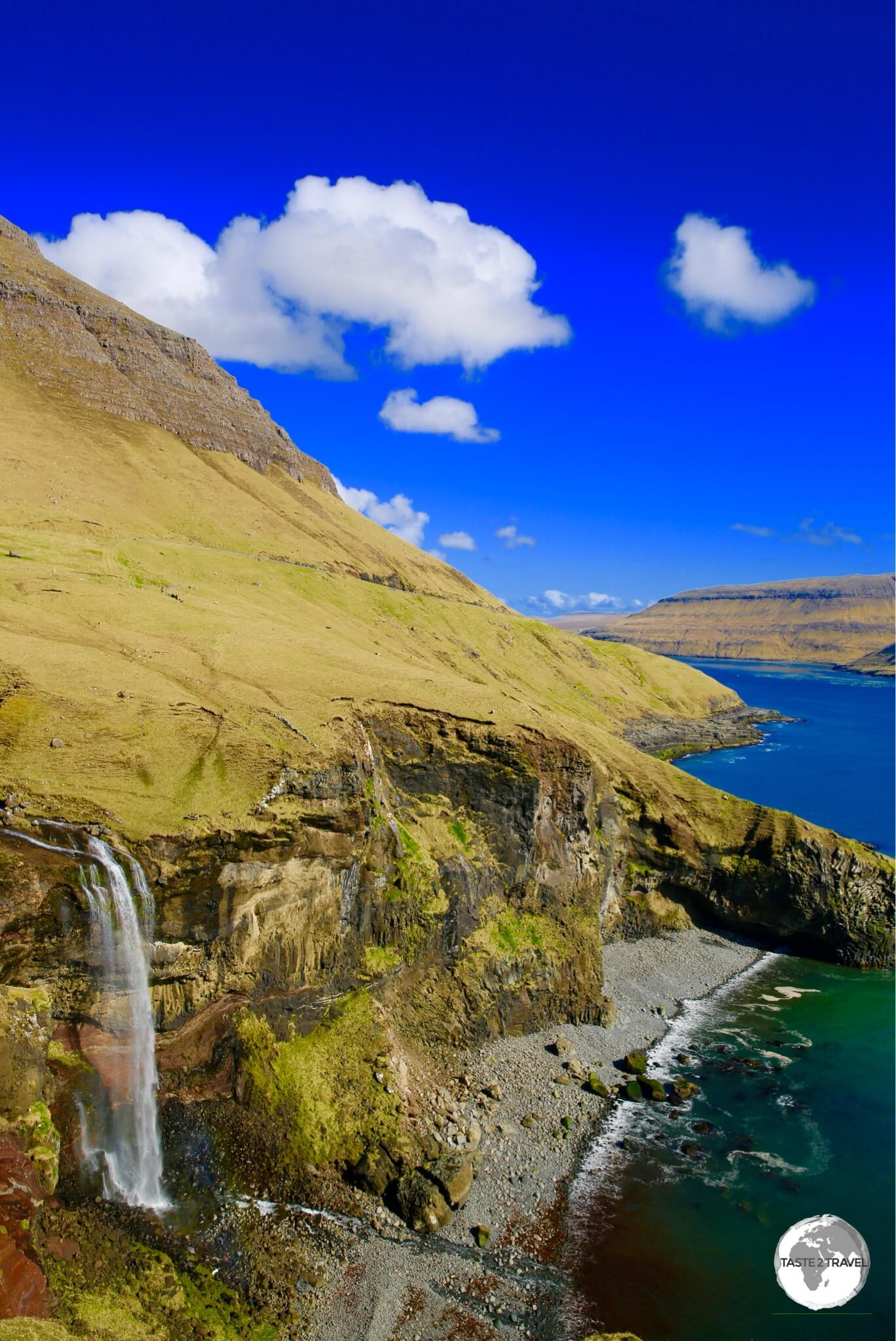 No shortage of spectacular scenery on the Faroe Islands, including this dramatic waterfall plunging onto a remote pebble beach on the island of Vagur.