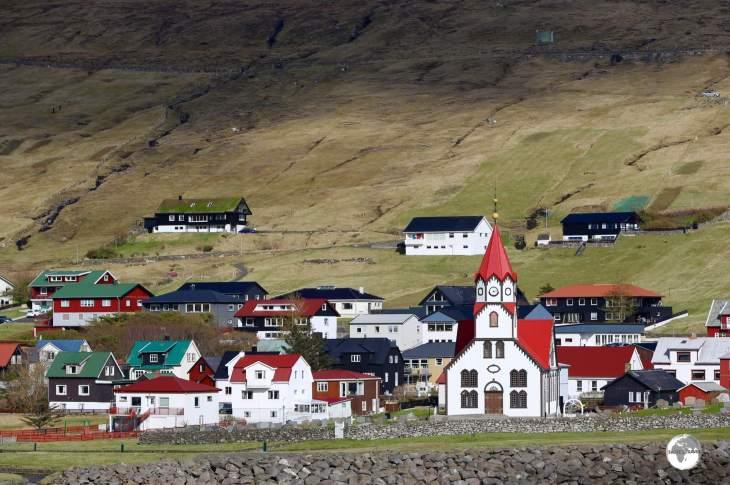 The striking church of Sandavá dominates the village of Sandavágur.