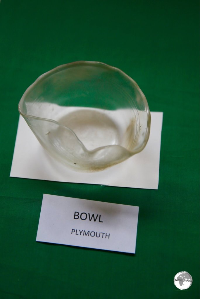 A display at the Montserrat National Trust shows a glass bowl, bent out of shape, by the heat of a pyroclastic flow which devastated Plymouth.