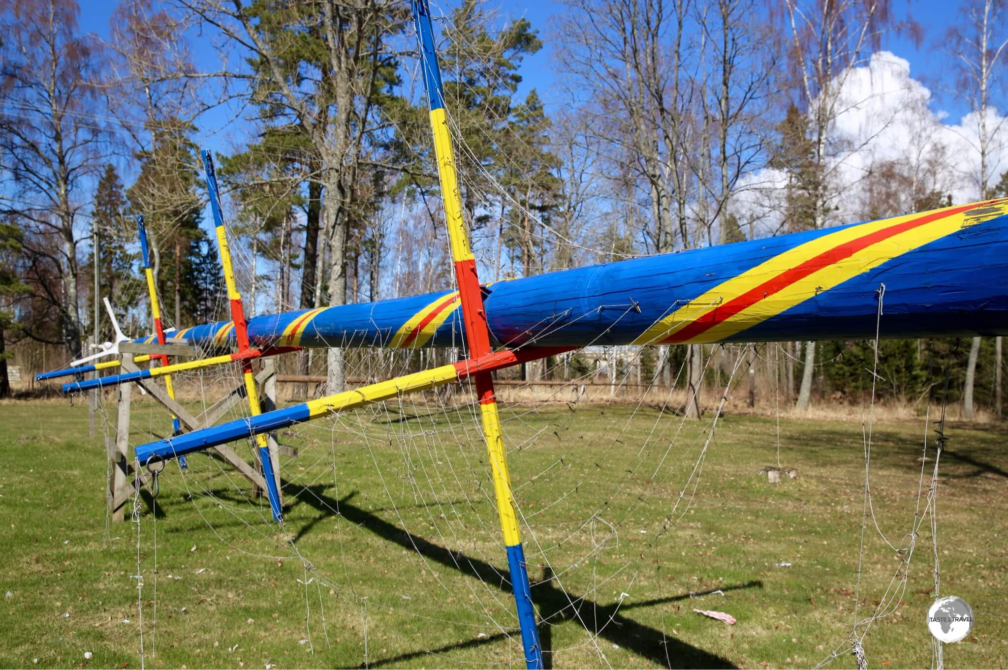 A Maypole painted in the Aland colours being prepared for the upcoming mid-summer festivities.