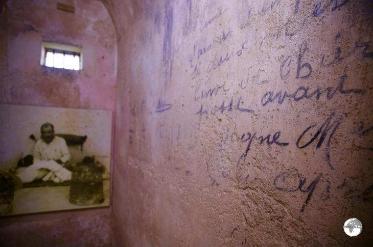 Convict graffiti decorates the wall of a cell at Fort Téremba.