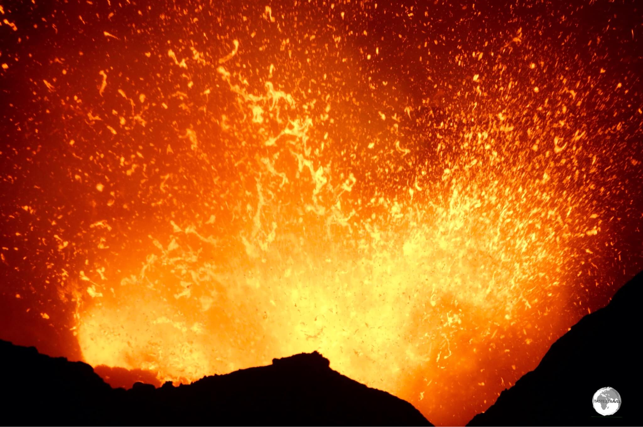 A spectacular sight, an explosive burst of activity, as viewed from the edge of the rim of Mount Yasur Volcano on Tanna island.