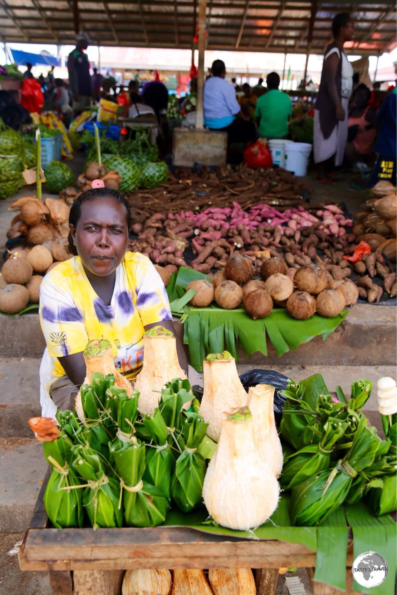 A seller at Gizo market.