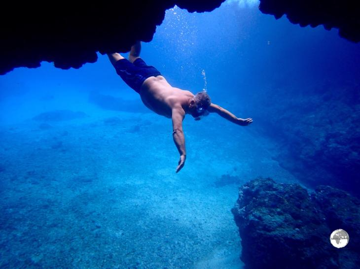 Yours truly making a graceful entry into the Blue Cave on Tanna.