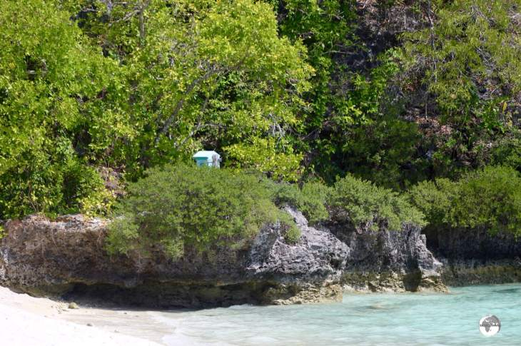 Can you spot the hidden post box? A lonely post box installed on an isolated beach on Lelepa Island.