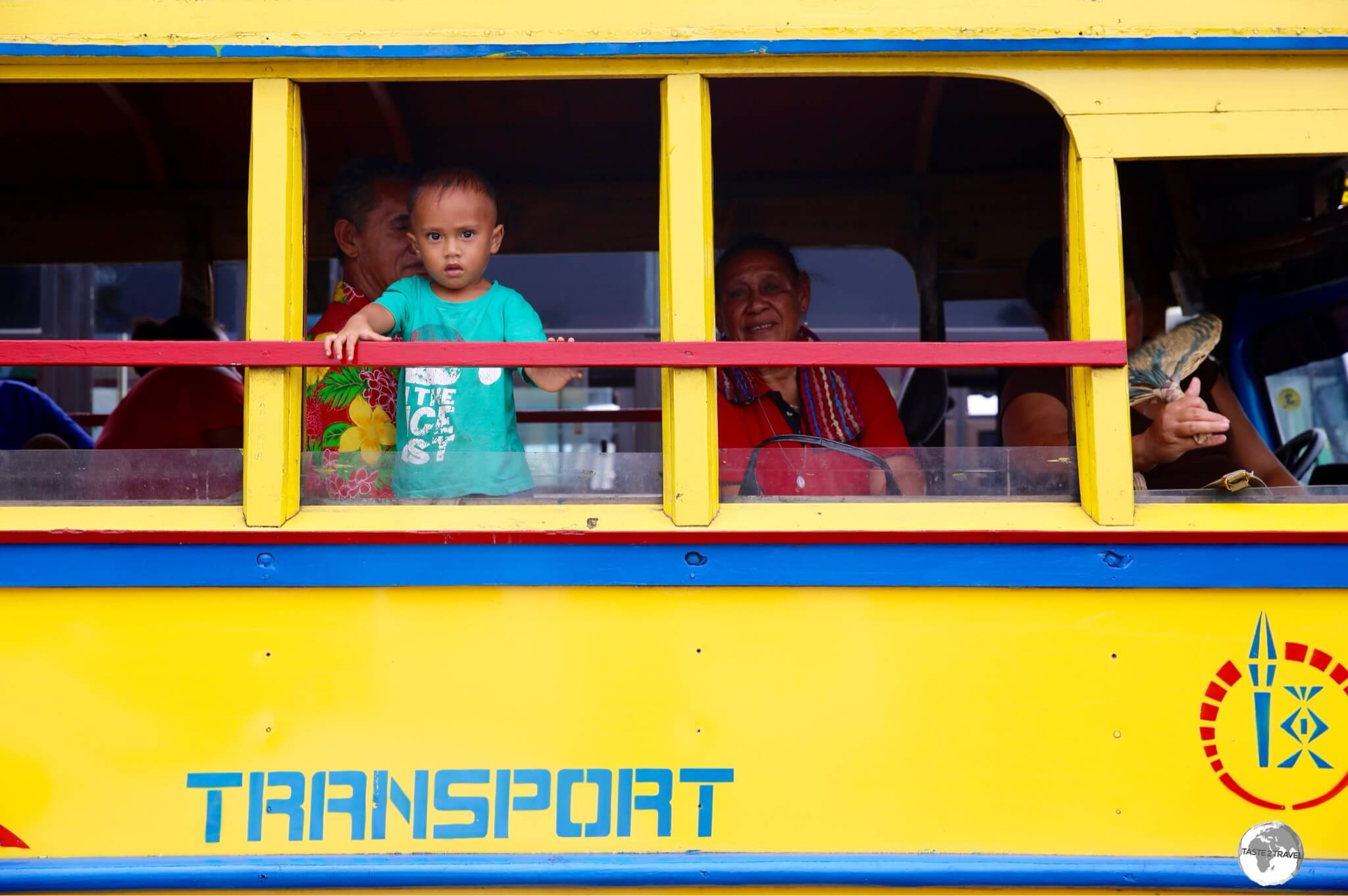 A Samoan boy, waiting for his bus to depart from Apia.