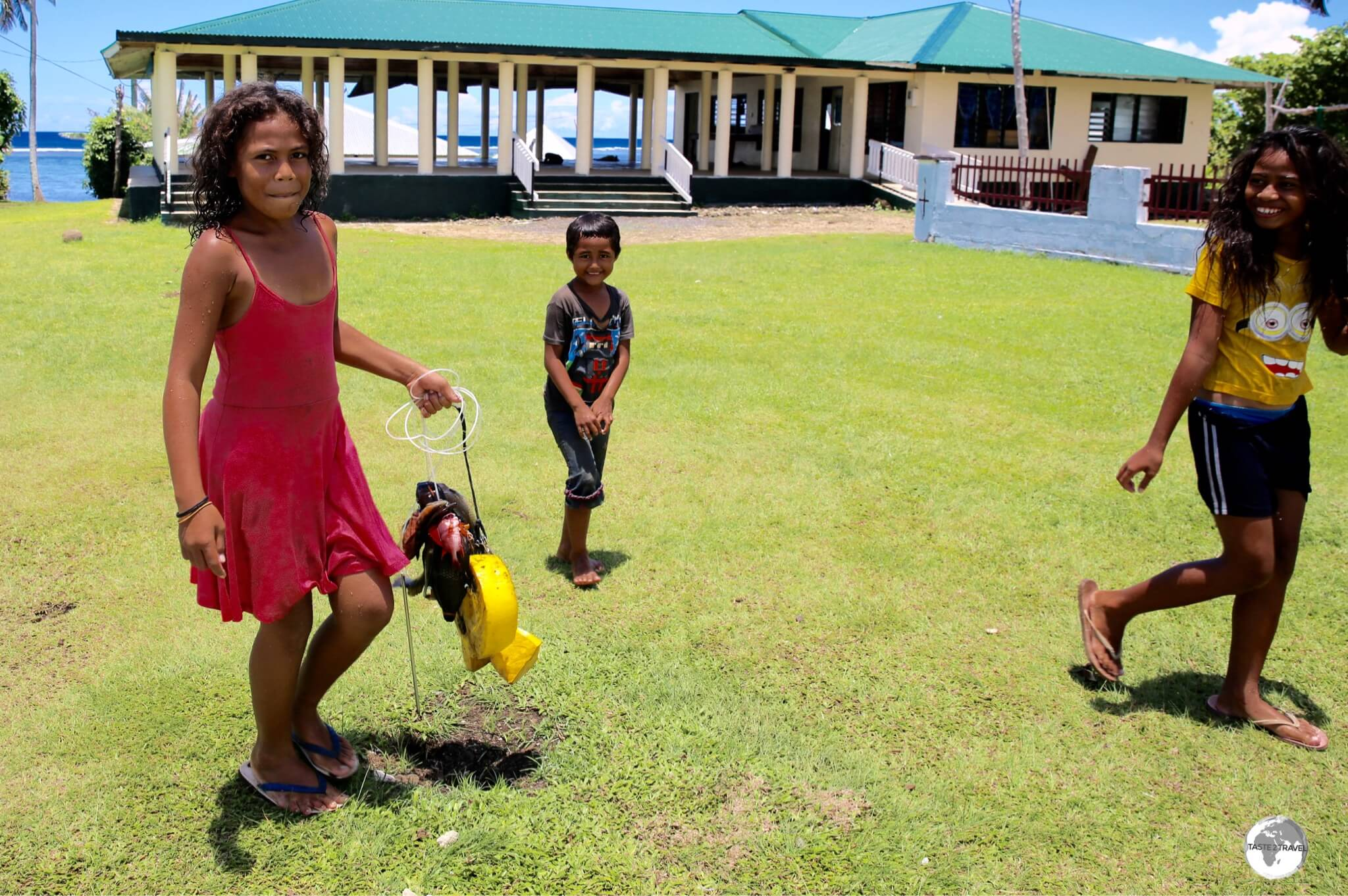 Children in Amaile returning home with the catch of the day.