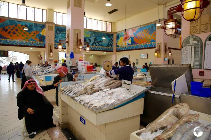 Colourful mosaics, featuring marine life, add to the pleasant atmosphere of the Kuwait fish market.