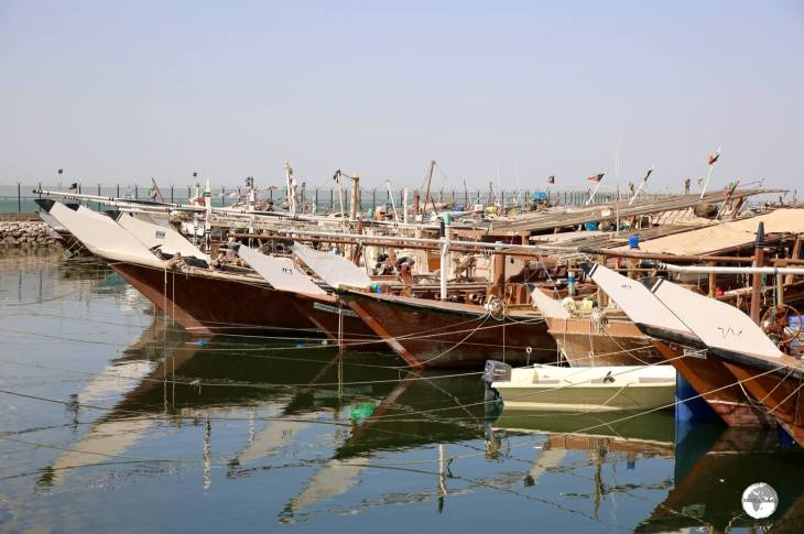 Traditional Dhow fishing boats line the Dhow harbour in downtown Kuwait.