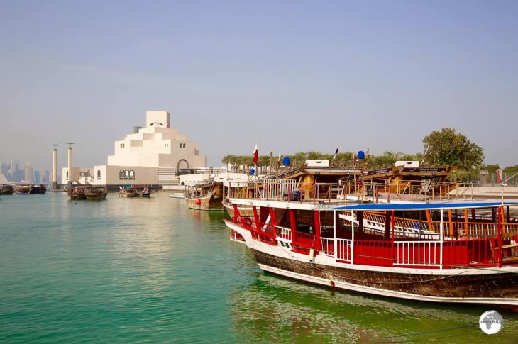 A traditional dhow boat and the Museum of Islamic Art, as seen from the Corniche.