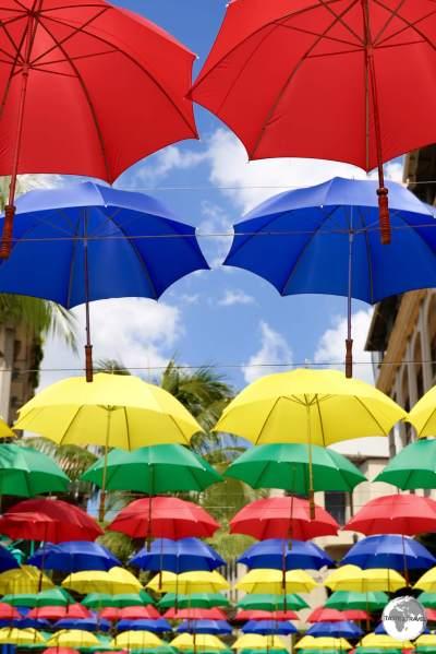 Colourful umbrella artwork provides shade at Le Caudan waterfront complex.