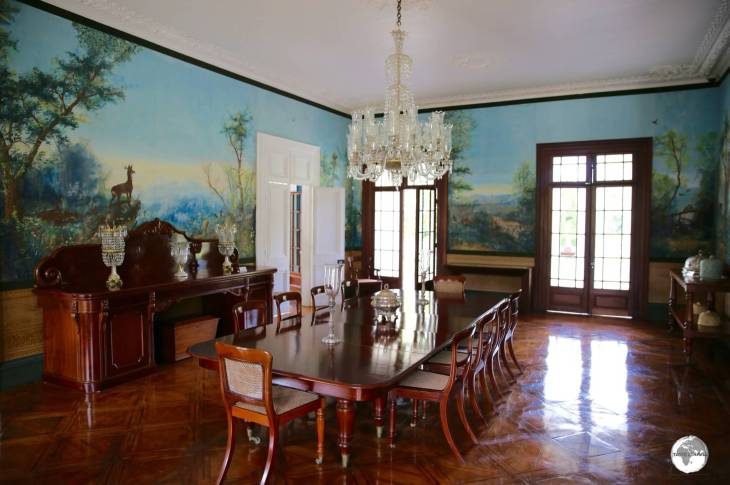 The dining hall at Château de Labourdonnais is lined with hand-painted wallpaper.