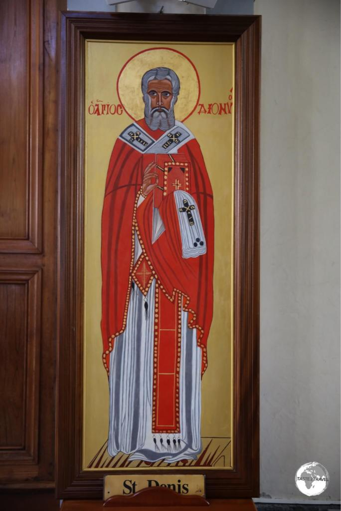 An image of the patron saint of the city - Saint Denis - on display inside the cathedral.