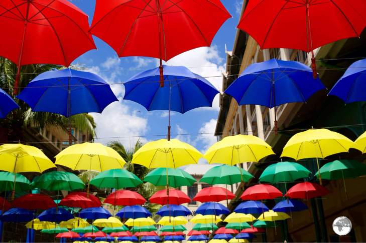 Colourful umbrellas provide shade on the pedestrian mall at Le Caudan Waterfront complex.