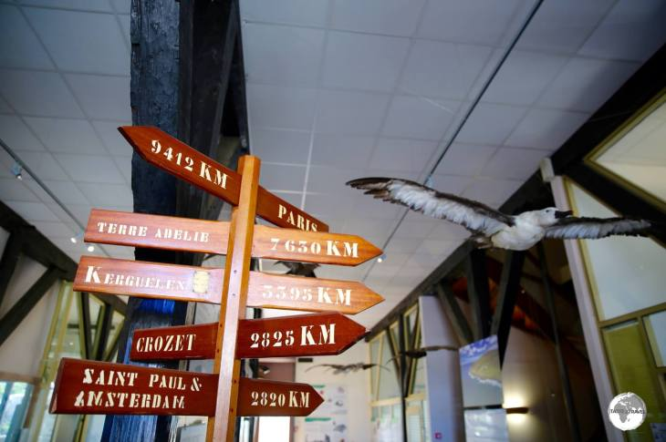 A marker inside the TAAF Information centre indicates distances to the various French Antarctic islands from St. Pierre.