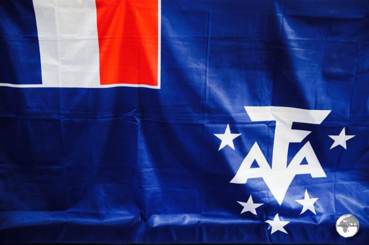 The flag of the <i>Terres Australes et Antarctiques Françaises (TAAF)</i> at the TAAF Information centre in St. Pierre.