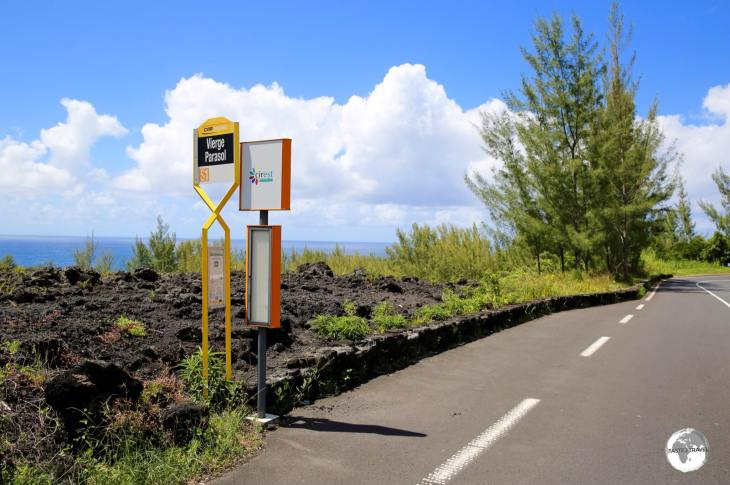 "The bus stop at ""Vierge Parasol"", which is located in the middle of an isolated, south coast lava field."