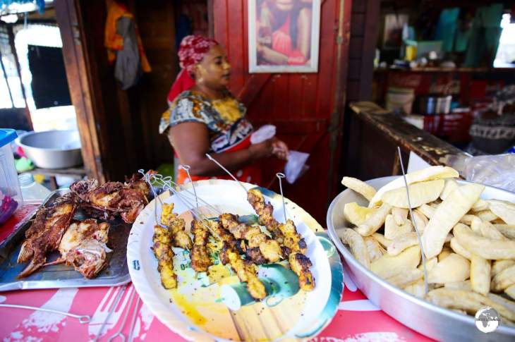 Food stalls at Mamoudzou central market offer affordable local food.