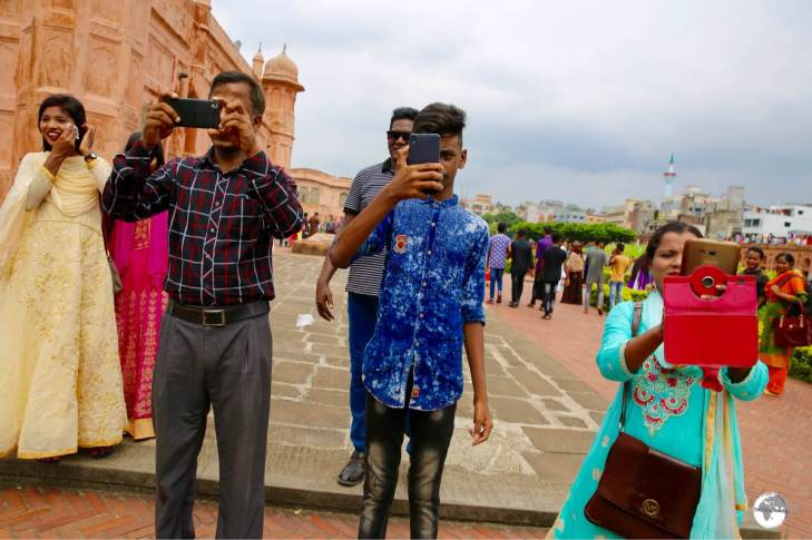 Me photographing three locals who requested I pose for selfies with their family members at Lalbagh fort.