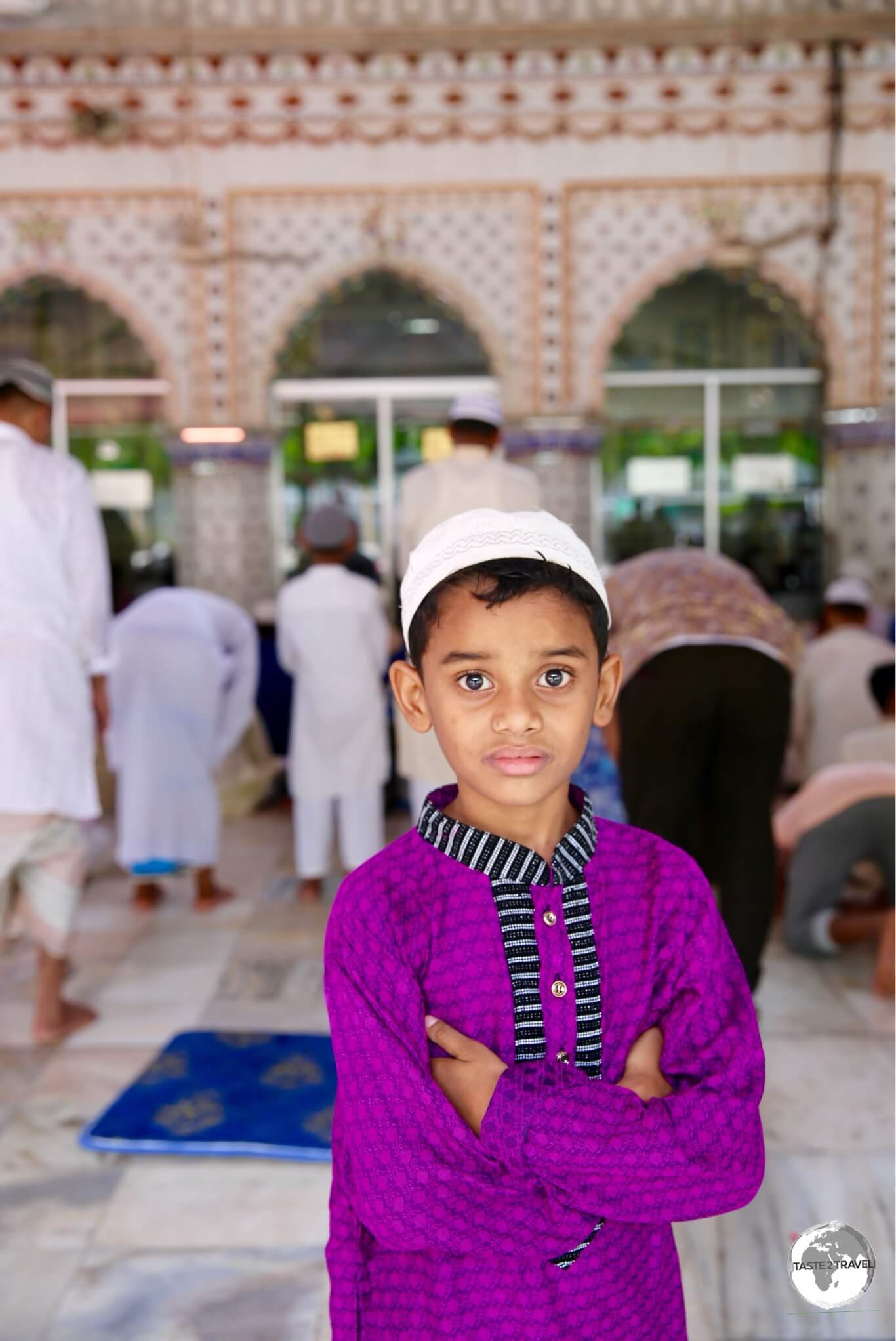 A young worshipper at the Tara mosque in Old Dhaka.
