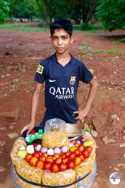 A young snack vendor in Suhrawardi Park.
