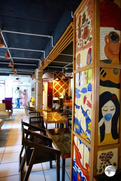 Artwork on the walls of the trendy Kiva Han Cafe, which is located in the upscale Gulshan district.