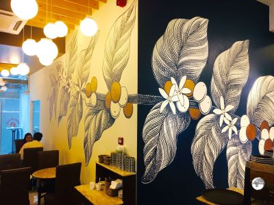 Artwork on the walls of the Banani branch of North End Coffee Roasters.