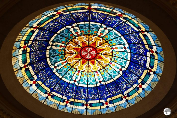 The beautiful stained-glass dome at the Beit Al Quran museum mosque.