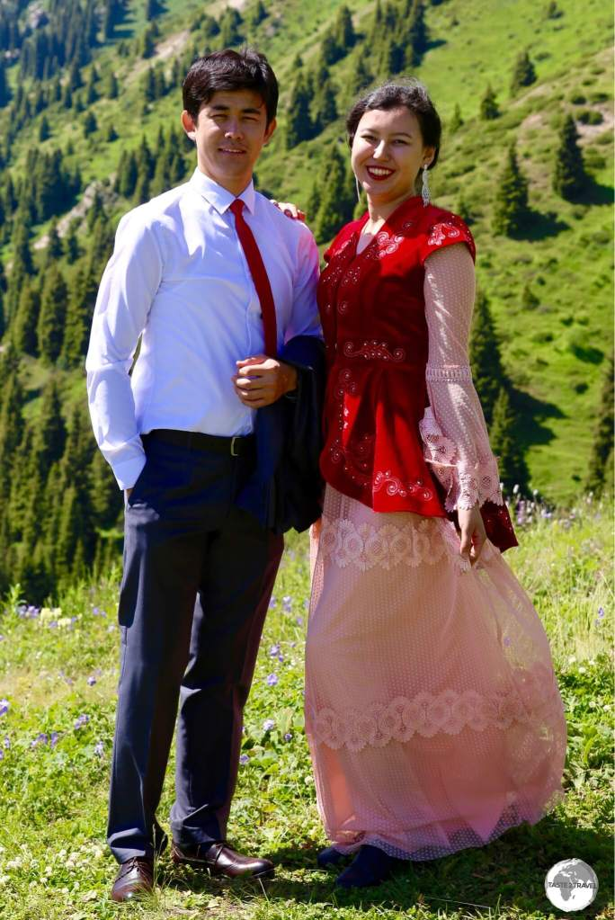 A newlywed Kazakh couple enjoying an outing on the shores of Big Almaty Lake.