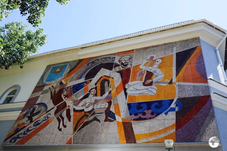 A mosaic dedicated to the 'The Hunt' adorns the wall of the KIMEP University Great Hall on Abai avenue.