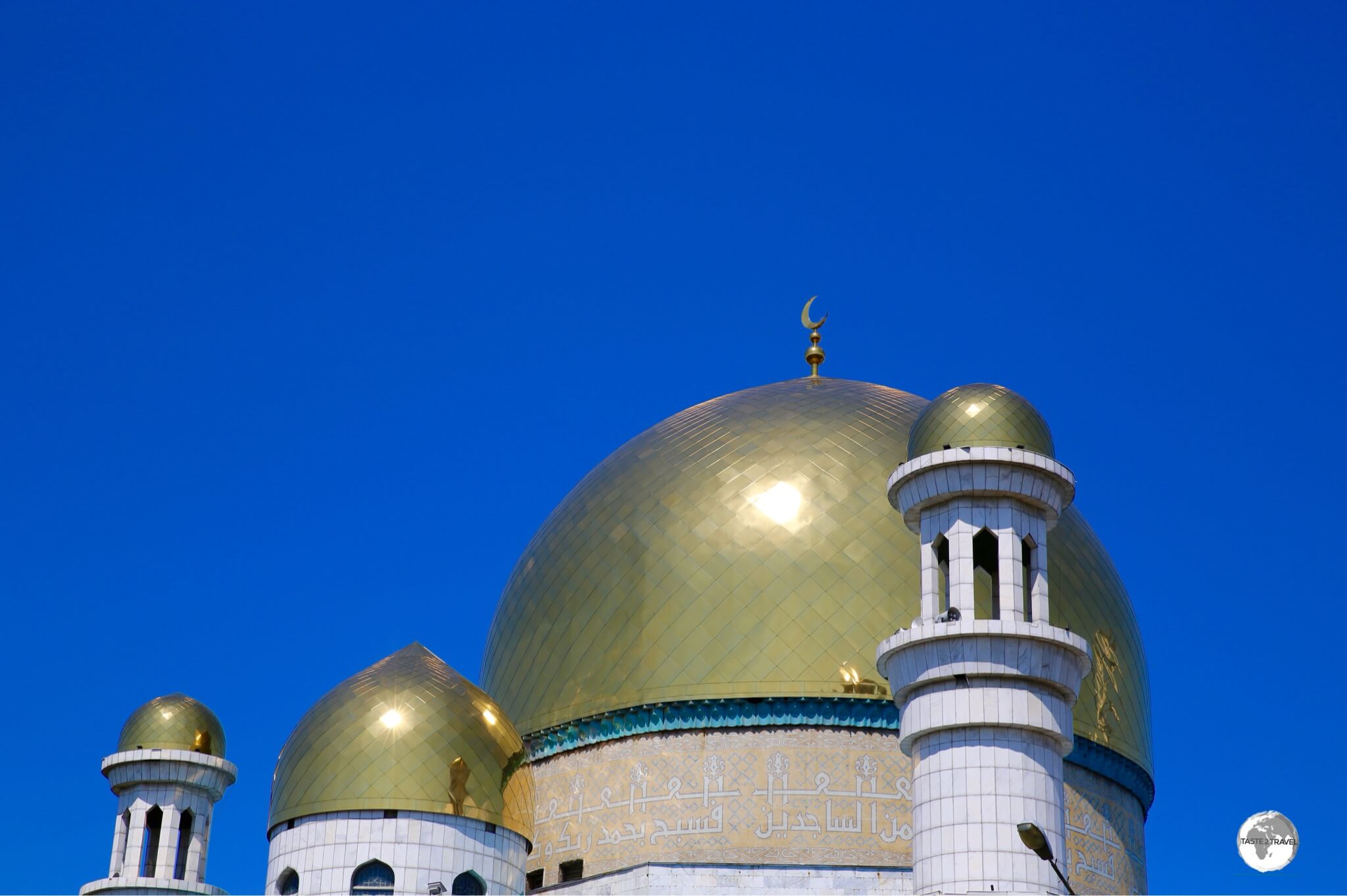 The large gold dome of the Almaty Central Mosque is decorated with verses from the Quran.