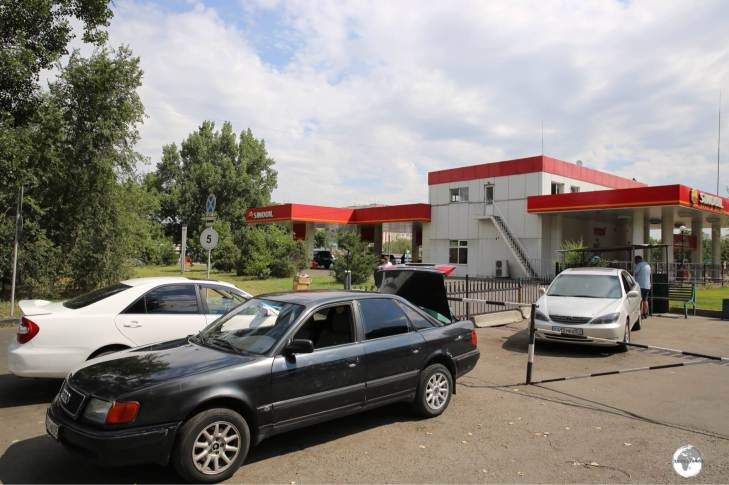 Shared taxis for Bishkek waiting at Sayran bus station in Almaty.