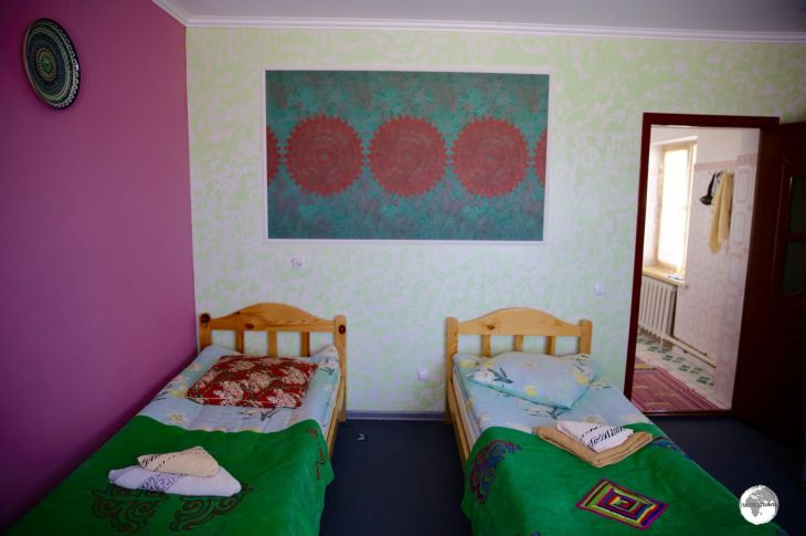 My room at the <i>Emily Guest House</i> in Bokonbayevo, a typical Kyrgyz home-stay style room.