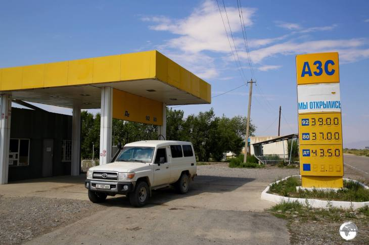 Filling up my two-tank Land Cruiser at a petrol station in the remote town of Ak-Tal, the first and only station in hundreds of miles.
