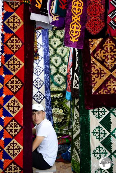 A shop-keeper at the Jayma bazaar in Osh.
