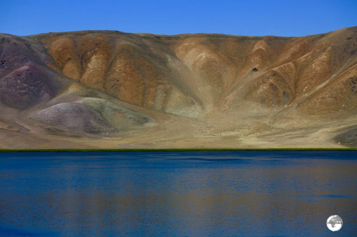 Different minerals provide a colourful backdrop to Bulunkul lake.