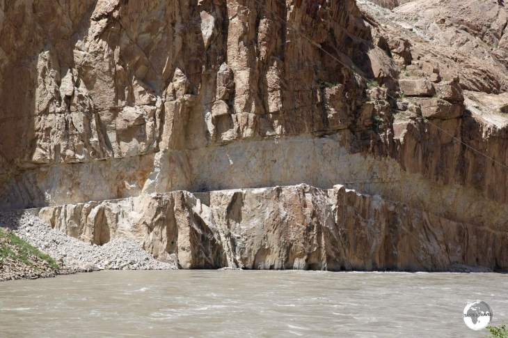 A road on the Afghanistan side of the Panj river which has been carved out of the cliff face.