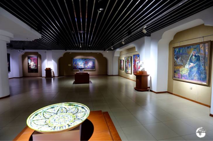 A display hall at the Tajikistan National Museum, featuring works by local artists.